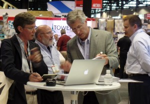 Henry Taylor of Kawneer deep in architectural conversation at his company's booth.